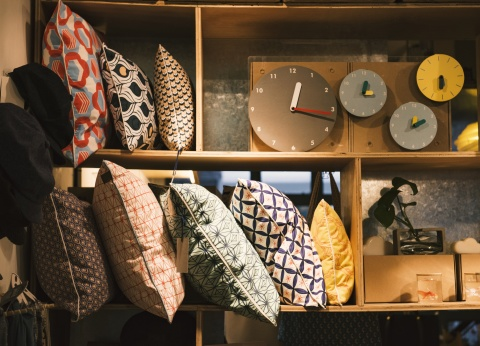 pillows and rugs on shelves